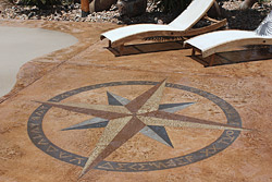 Payette used a compass to align the compass rose directionally and used stencils for the letters depicting direction, dremeling the edges to get a rough appearance. The rest he did freehand with a dremel, a truss strap and a framing square.