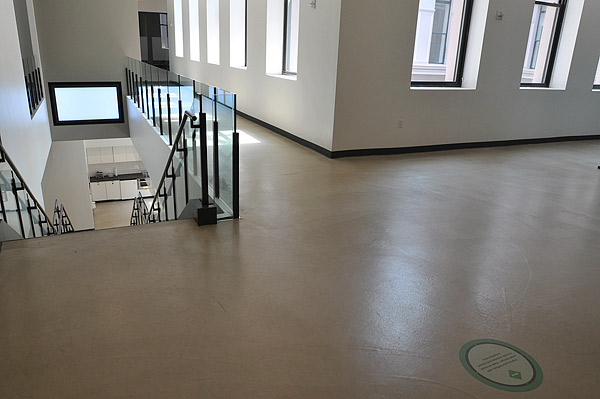 Gypsum Concrete Flooring : Fast install of microtoppings in old building pushes