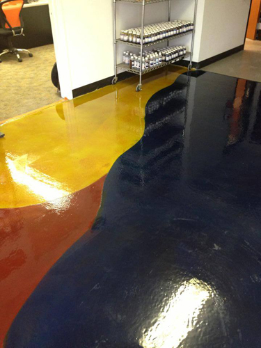 At The Stain Store's new location in north Austin, Texas, 600 square feet of flooring in the showroom and tool room was overlaid with Miracote MPC, scored with curved joints, then stained with Mirastain II alcohol-based stain, Butterfield Elements. 2