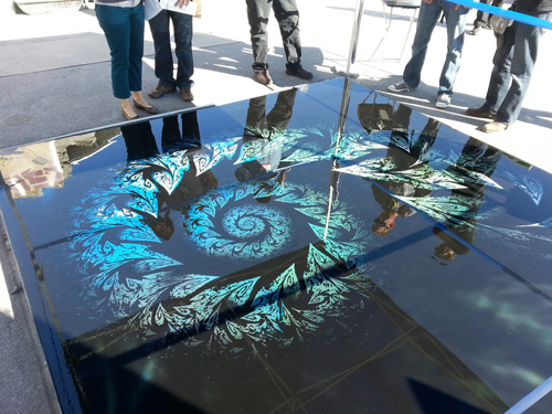 A look at the fractal design created with stencils on concrete.