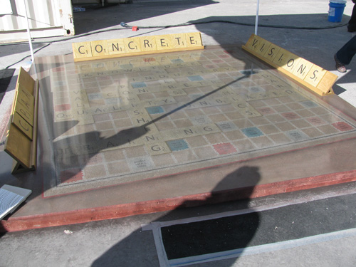 A larger than life Scrabble board with tiles made of concrete and stained to the appropriate colors and squares