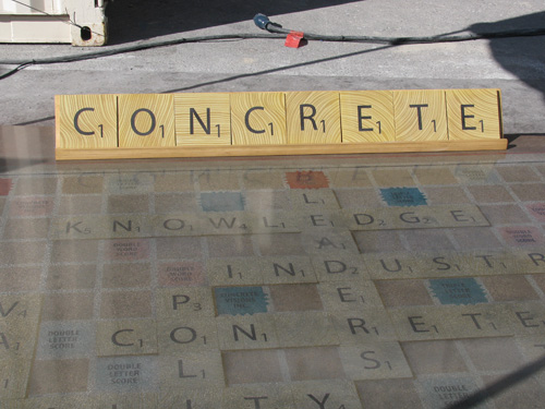 The word CONCRETE spelled out with concrete scrabble letters.