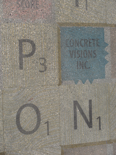 P O and N letters made of concrete to emulate scrabble pieces.
