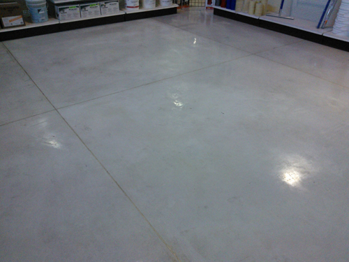 The unsightly spilled concrete stain has been removed with acid gel.