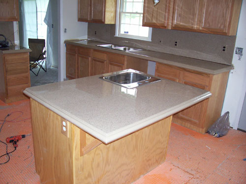 A kitchen island complete with concrete countertops.