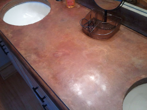 A double sink is embedded into this countertop and is edged with z-counterform products.