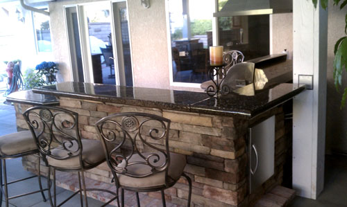 Outdoor kitchen complete with concrete countertops.