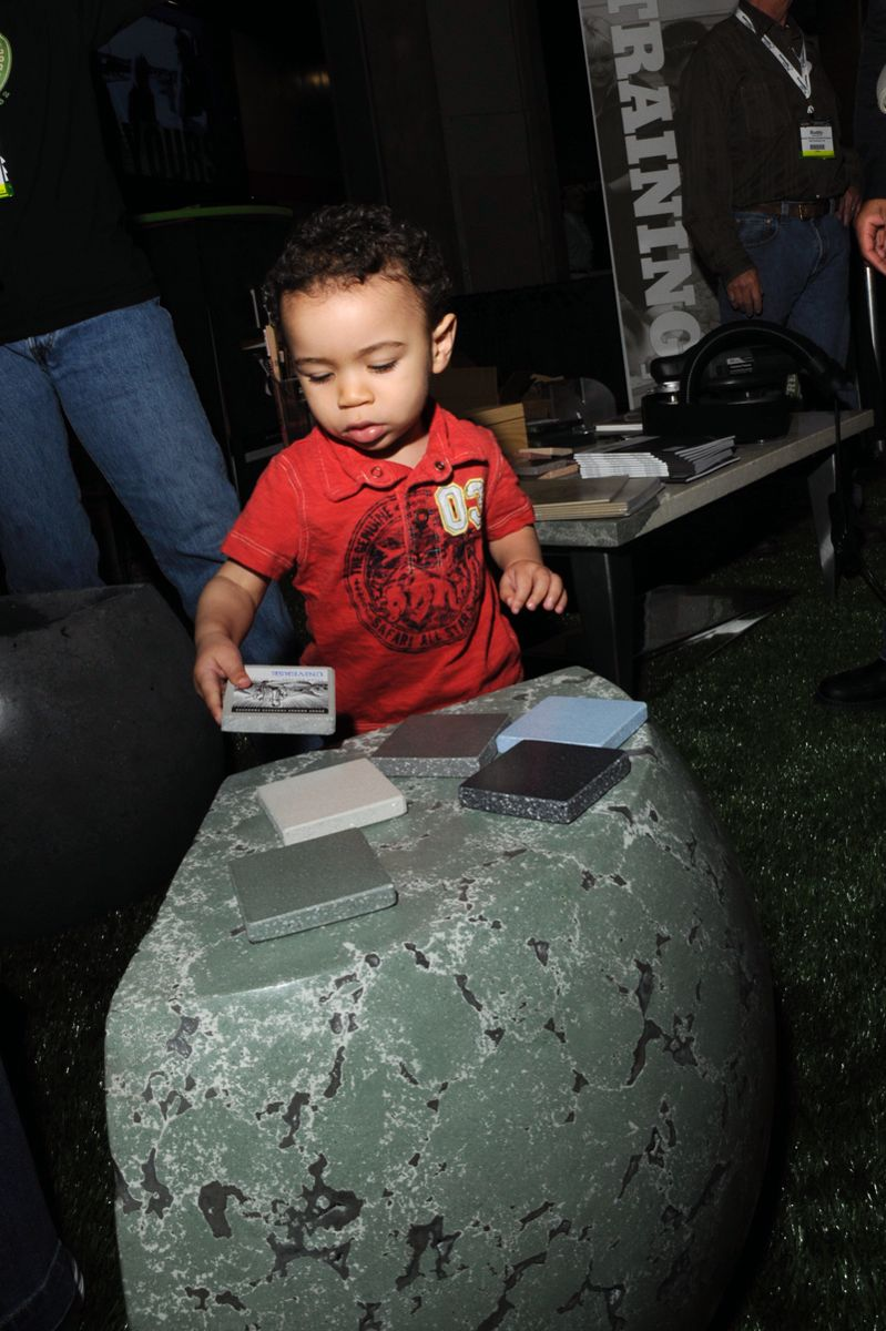 This is Brayden Hailey considering some samples at the 2011 Concrete Decor Show & Spring Training. His parents, Brandon and Carmen, came to Nashville from Southaven, Miss., where Brandon operates Concrete Alternatives.