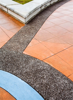 Decorative concrete patio with vibrant red and blue stained concrete