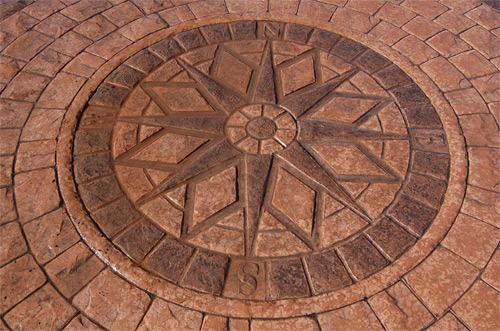 A design created using the Cobble Circle radial stamp set and a decorative center medallion from Specialty Concrete Products.