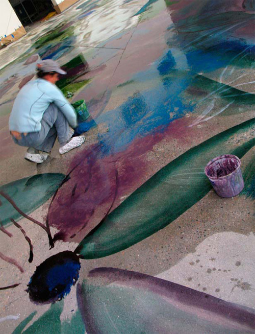 "Kelley Burnham wields really big brushes and even mops to yield a really big ""watercolor. "" Art techniques such as bleeds work equally well on rag paper and ground concrete."