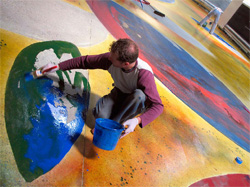 Concretist artist associate Martin Webb applies thinned water-based acrylic, intensely saturated with Deso Dye Concentrates and Aquacolors from Colormaker. The layout and material application was done by hand and by eye, with no mechanical aids. That's one really big watercolor!