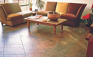 A water based stained concrete sun room floor. Unique finishes are obtained by using multiple colors of concrete stain.