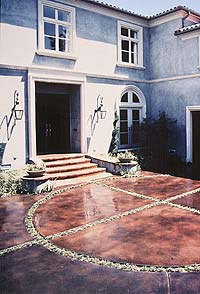 A stained concrete circular patio. Today, contractors and developers are specifying and installing intricately textured cast concrete into foyers, lobbies, garden pathways, and even countertops.