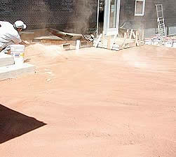 Throwing Color Hardener onto concrete for a non gray looking concrete slab.
