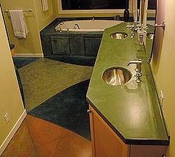 Concrete countertops know no limits and can be shaped however the installer would like as is seen here in this green trapezoidal countertop.