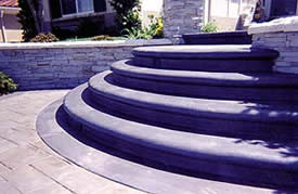A 5 step riser of concrete steps creates an elegant entrance to any home.