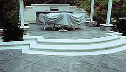 Elevated outdoor living with these radial concrete steps creates a very clean and sophisticated look on any patio.