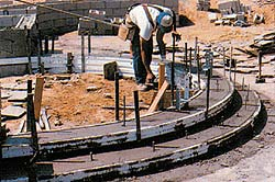 Forms are set for a radial concrete step formation.