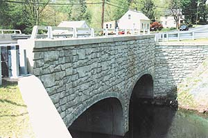 Quaint bridge over small stream with a stone look made from concrete using Increte Systems