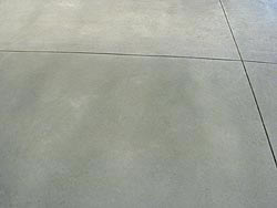 Concrete Burnishing -When you burnish, you're making the surface slick and very smooth, as well as altering the color.