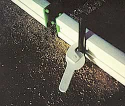 Plastiform forms have a very easy cam-lock clamp that fastens the forms to the concrete stakes.