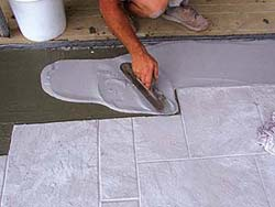 Renew Crete Stampable concrete Overlay Mix is easy to apply and gives the contractor a peace of mind that the product is quality. Troweling an overlay mixture before stamping it to look like stone tile.