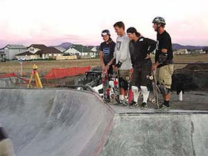 Michael Dahl and others from Airspeed Skateparks watching a skater doing tricks.