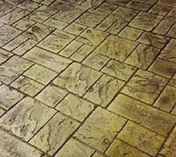 To eliminate unwanted lines in a stamped concrete project run the pattern at an angle.