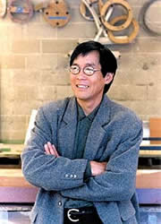 Fu-Tung Cheng stands in his workshop where is designs and constructs concrete countertops and furniture.
