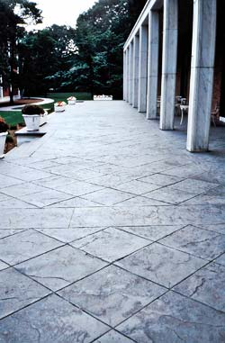 Bomanite materials used to create a diagonal placed tile like surface using concrete stamps, texture skins, and saw cuts.