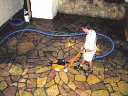 Maintaining Concrete using a swing brush makes quick work of dirty stained concrete floors.
