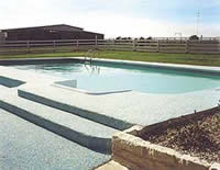 Pebble-Flex System used on a pool deck does not face from UV exposure.