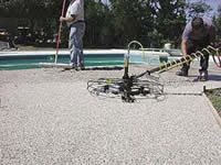 Pebble-Flex System can be finished with a power trowel to smooth the surface.