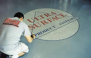Concrete Solutions creates a visual appealing logo on a concrete floor.