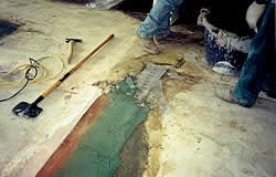 "Between the line of terrazzo and carpet there was a high difference of 1"" that had been filled with mortar. It came loose once they scarified the floor."