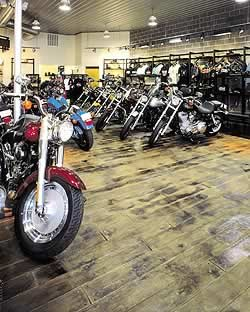 Indoor stamped concrete has increased in popularity as seen in this motorcycle shop.
