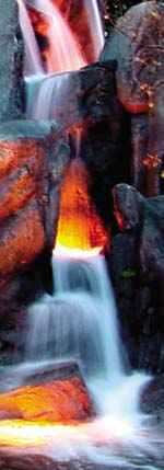 GFRC concrete rocks make this waterfall realistic. An orange glow makes the GFRC rocks look like ember from a fire.