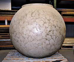 Buddy Rhodes Studio ball shaped concrete vase for outside plants.