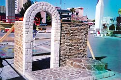 Flex-C-Ment Wall Mix is a cementitious coating that is carvable for vertical concrete applications, stone arch made from carving.