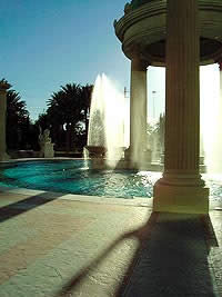 A fountain throws water near a textured concrete area that has been sealed using penetrating sealers.