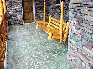 Stencil Systems designed a tile look pattern for this stone cabin's front porch. Multi colored overlay material was used to give the stencil work depth.