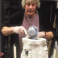 Carole Vincent working with concrete to create art.