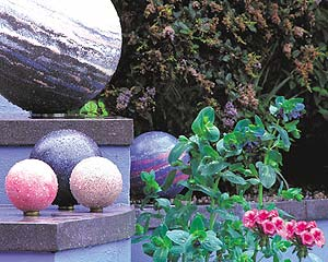 Carole Vincent and garden concrete balls of many colors.