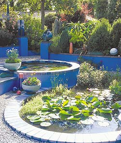 Carole Vincent constructed a brilliant blue tiered garden pond using concrete, bricks and round stone.
