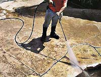 After concrete has set a contractor can begin washing off excess color hardener.