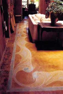 In this living room the concrete was cleared of tack strips and glue and then thoroughly cleaned.The lines and flowing curves were drawn freehand and etched with a diamond blade