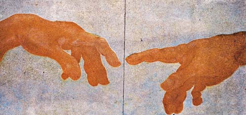 "These hands are from a Michelangelo painting: ""The Creation of Adam."" Engraving done with an angle grinder."