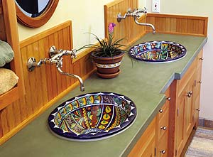 green Concrete Countertop with decorative sinks takes this washroom to the next level.