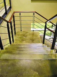 Colormaker Floors concrete coatings product used on busy high school stairs.